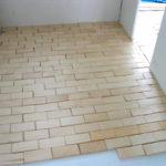 laying ceramic floor tiles as brick